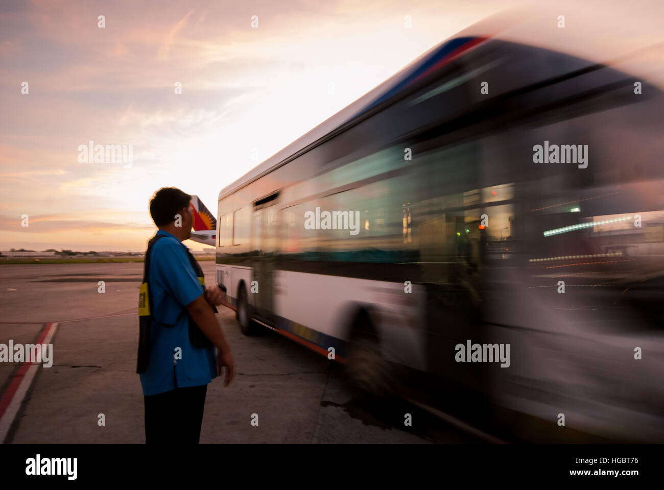 Airline transfer bus from the tarmac to the arrival area. - Stock Image