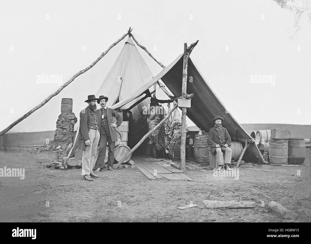 Dressed beef hanging in tent during American Civil War. - Stock Photo