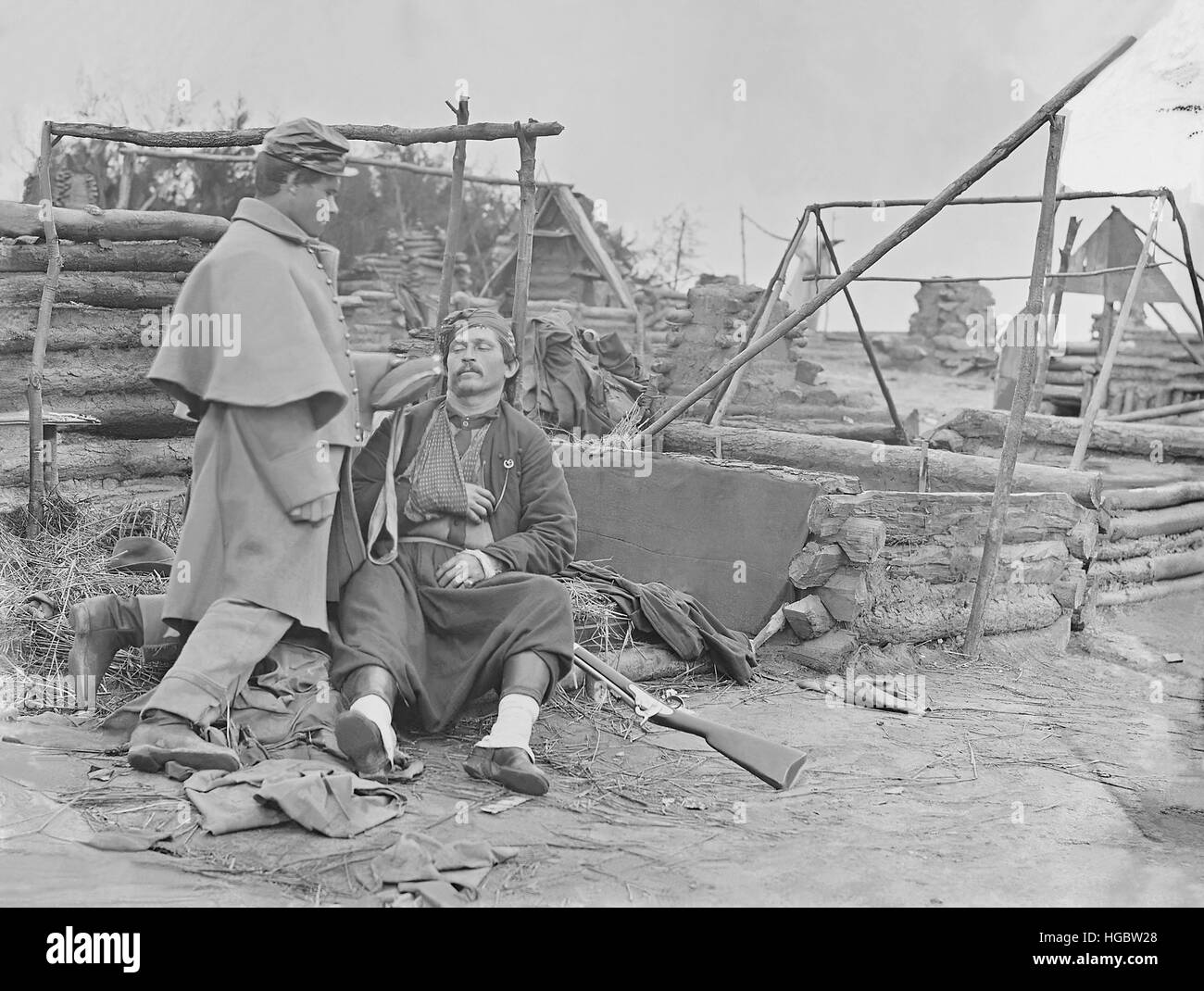 American Civil War scene of a deserted camp and wounded Zouave soldier. - Stock Image