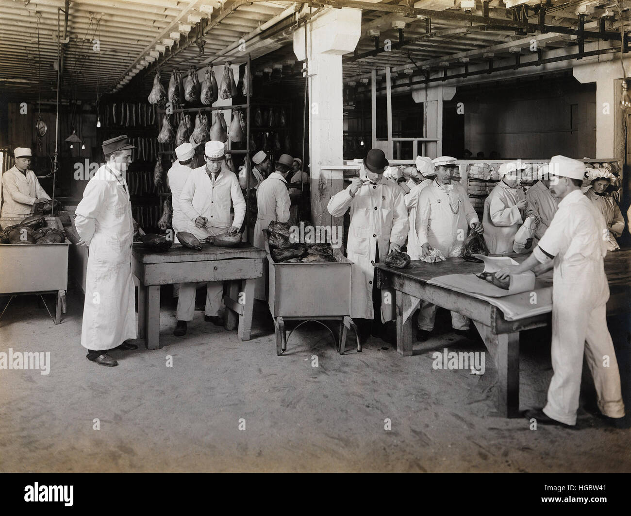 Branding smoked hams at the meat packing establishments, 1910. - Stock Image
