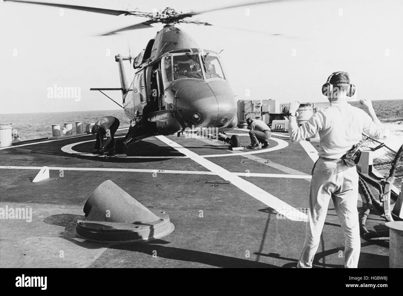 A UH-2 Seasprite helicopter lands aboard USS Coontz, 1969. - Stock Image