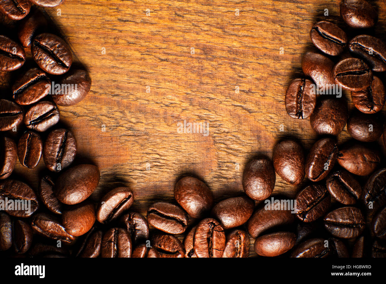 Coffee beans on wooden table close up - Stock Image