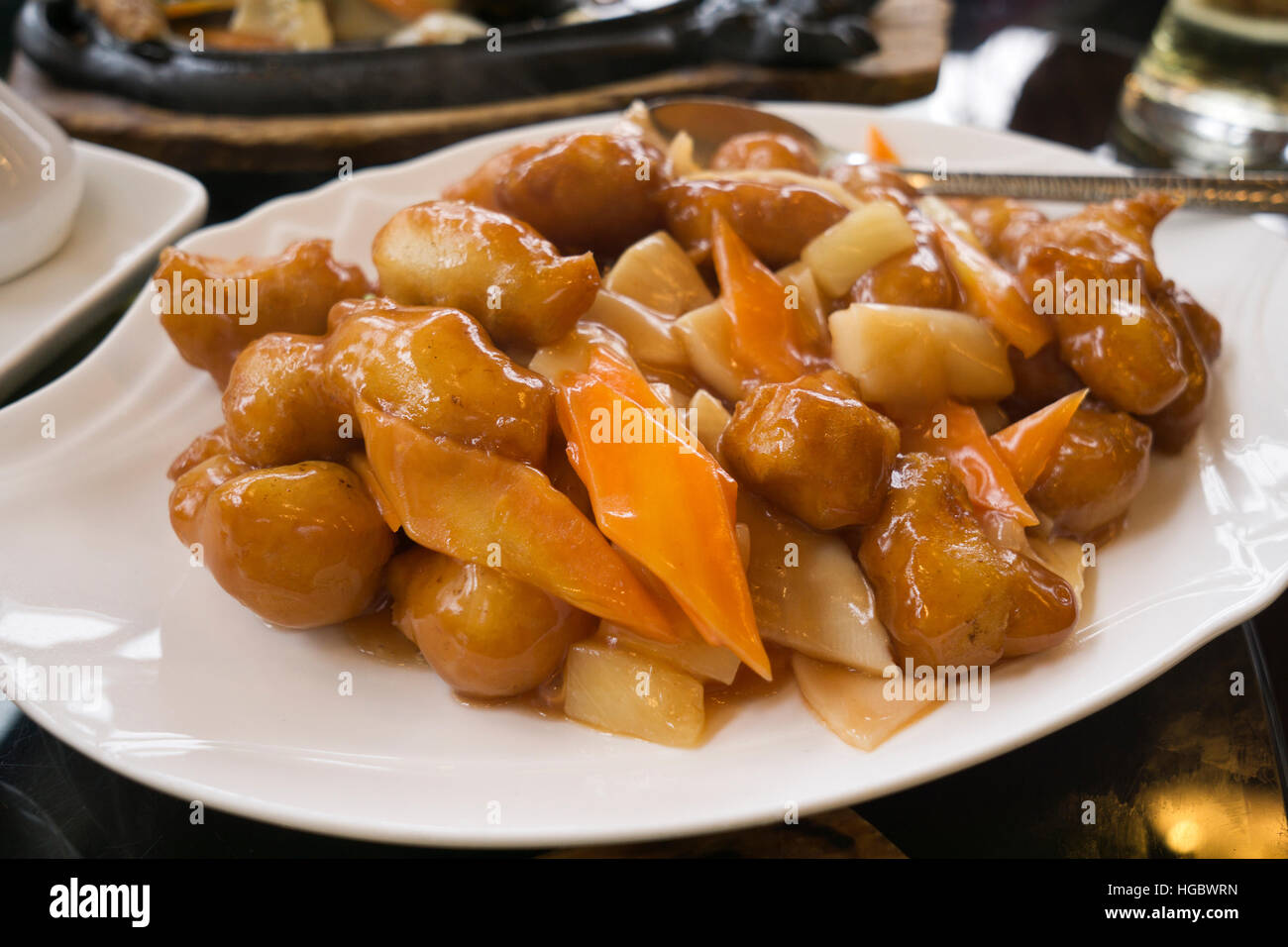 Sweet and sour chicken with vegetable on a plate - Stock Image