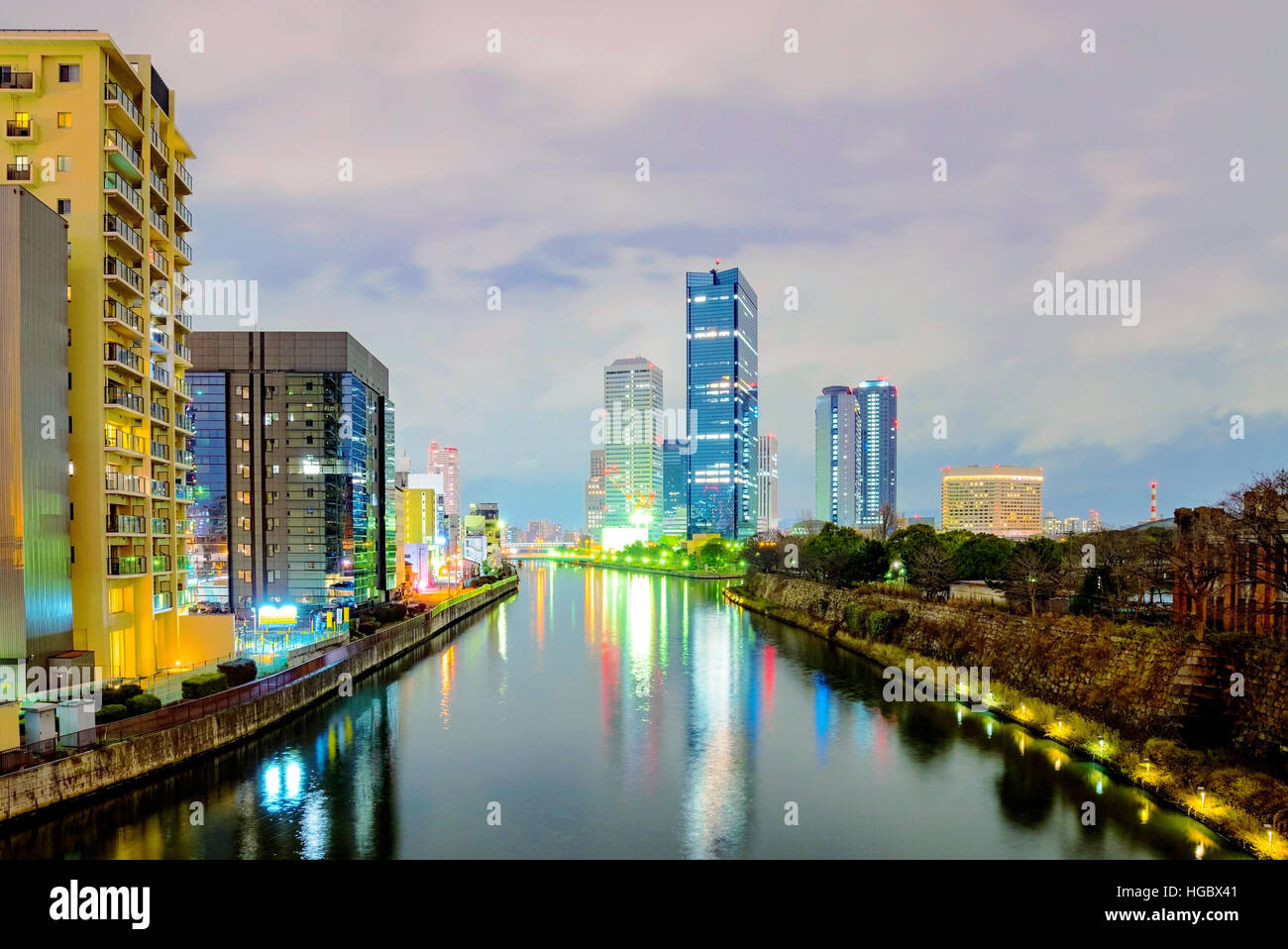 Osaka Business Park With City Buildings And River At Night