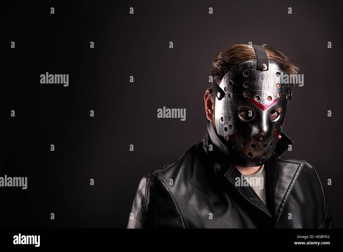 Bloody murderer in hockey mask portrait - Stock Image