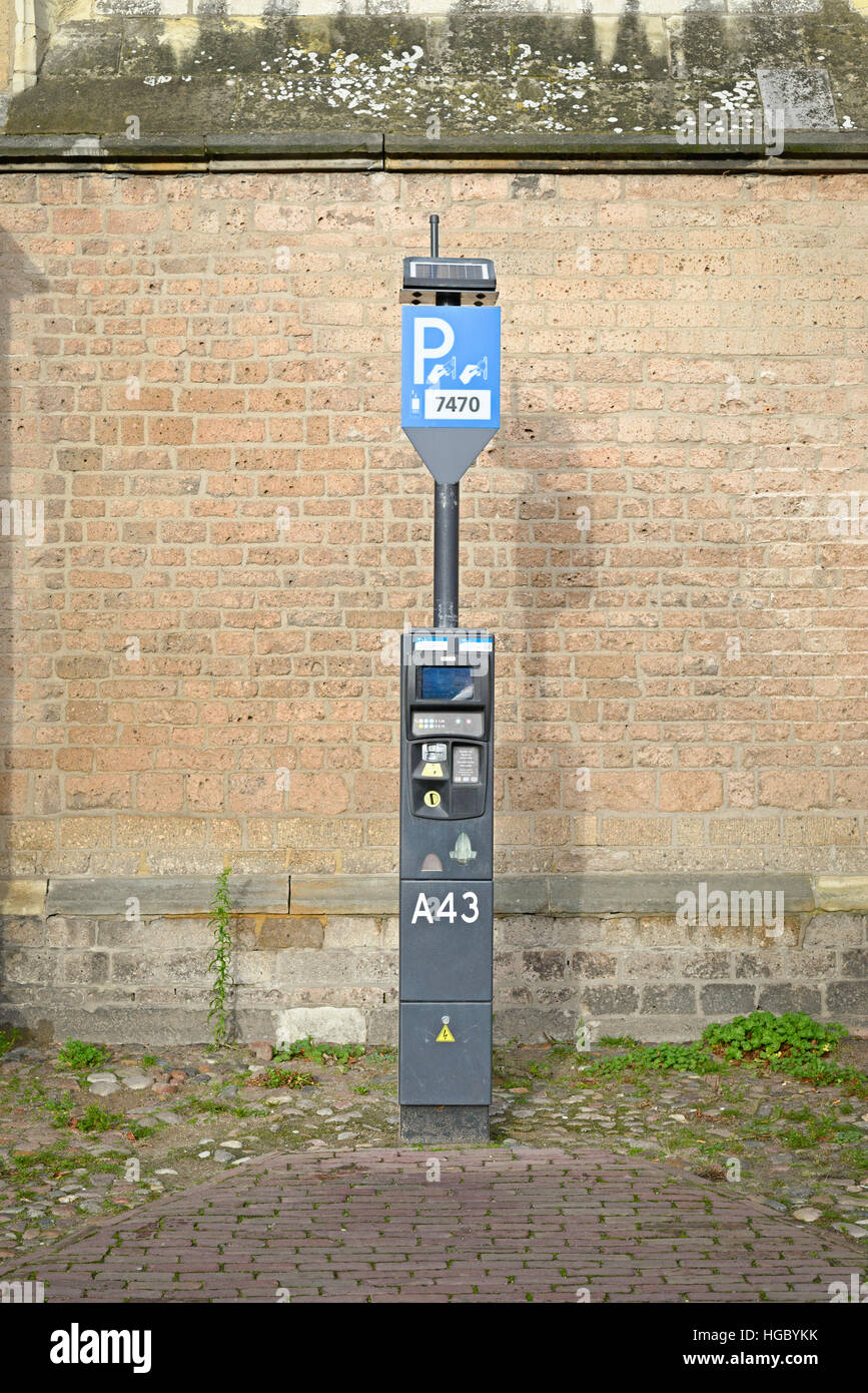 DEVENTER, NETHERLANDS -DECEMBER 24, 2016: Toll ticket parkingzone: an automatic device to pay for parking. Stock Photo