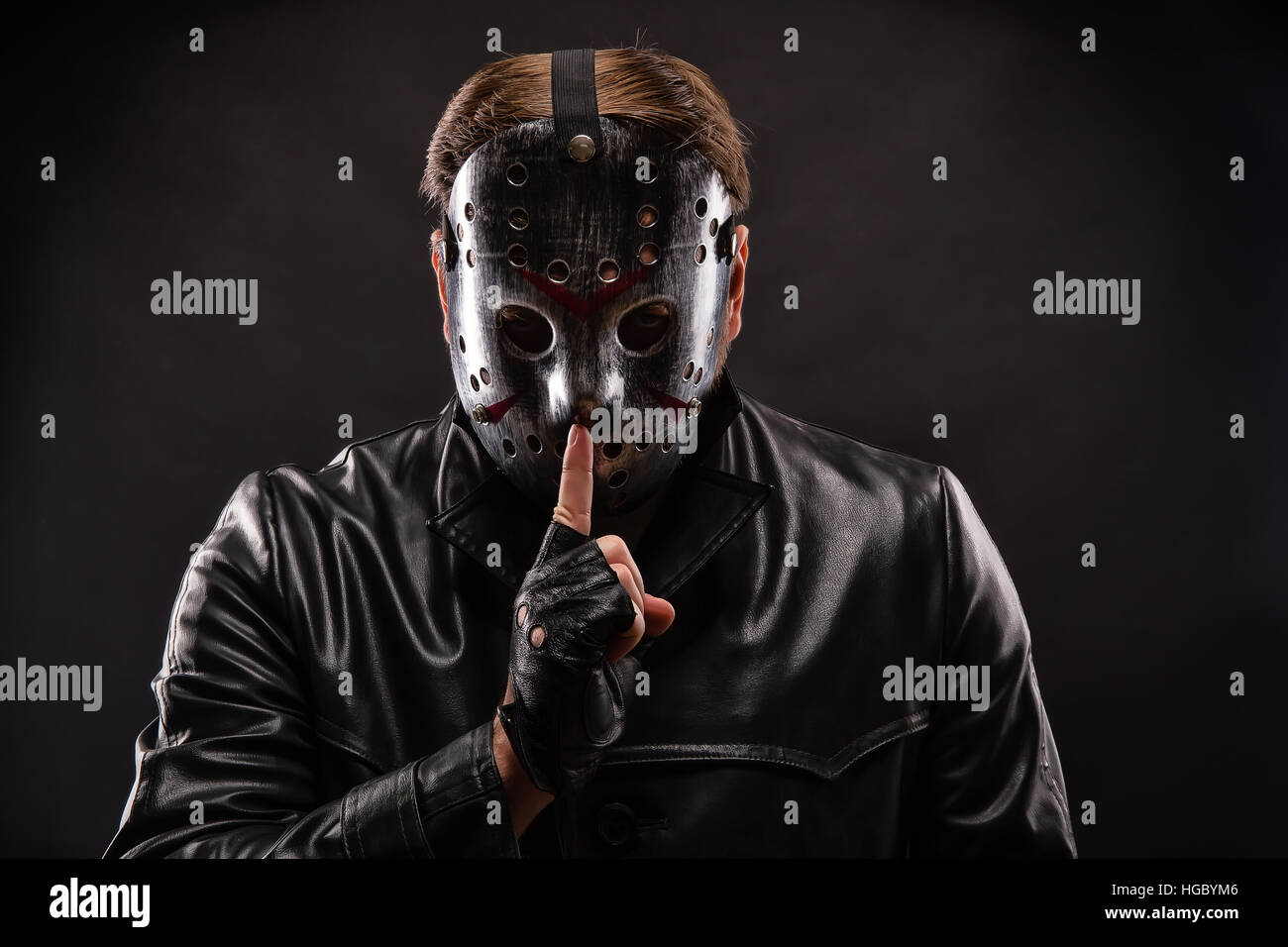 Serial maniac in hockey show do not talk sign - Stock Image