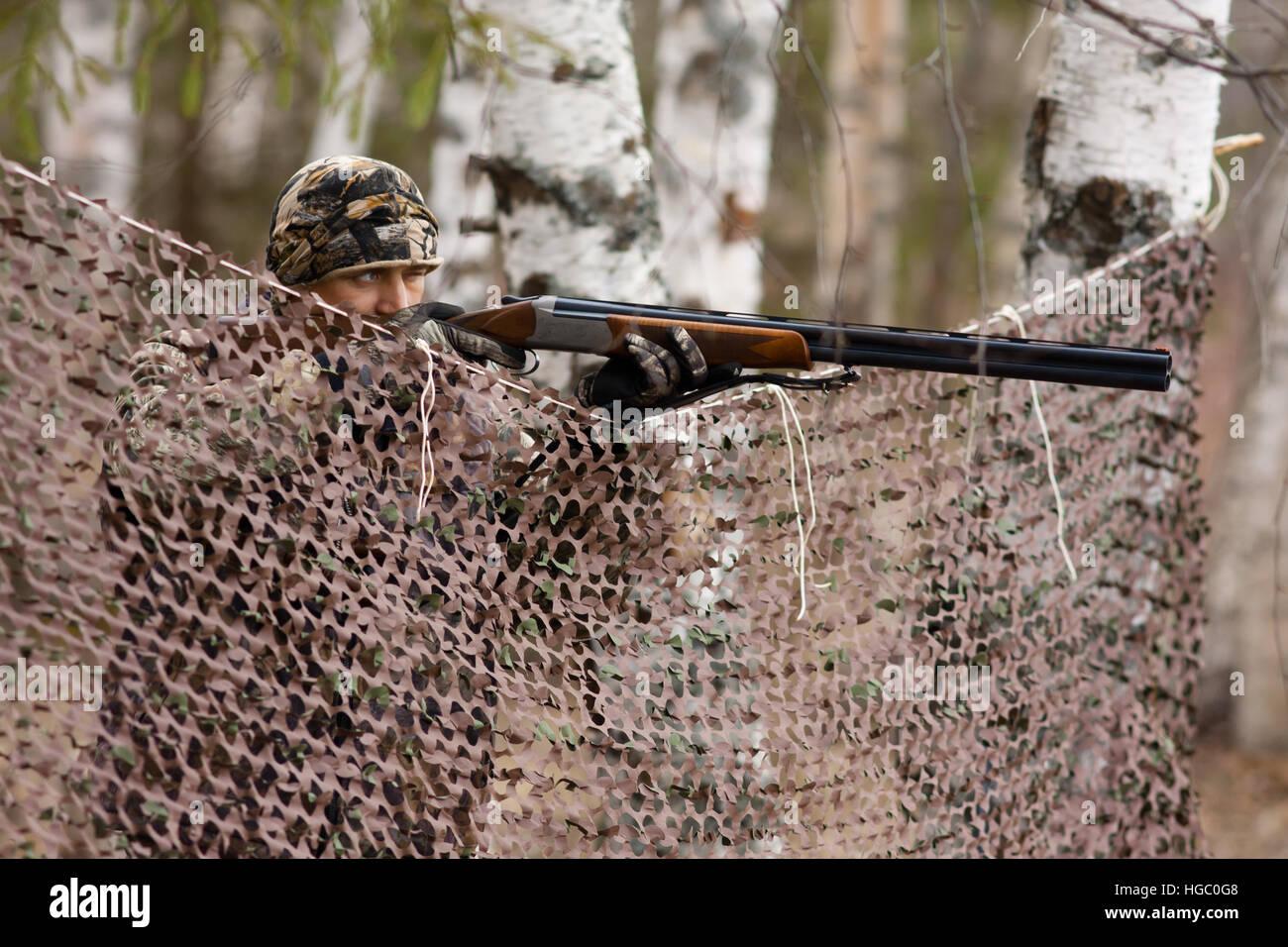 hunter aiming at the gamebird - Stock Image