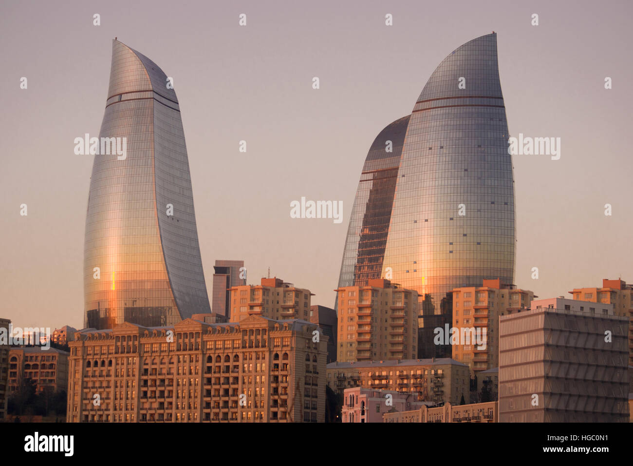 Flame Towers during sunrise of Baku. Flame Towers are new skyscrapers in Baku, Azerbaijan - Stock Image
