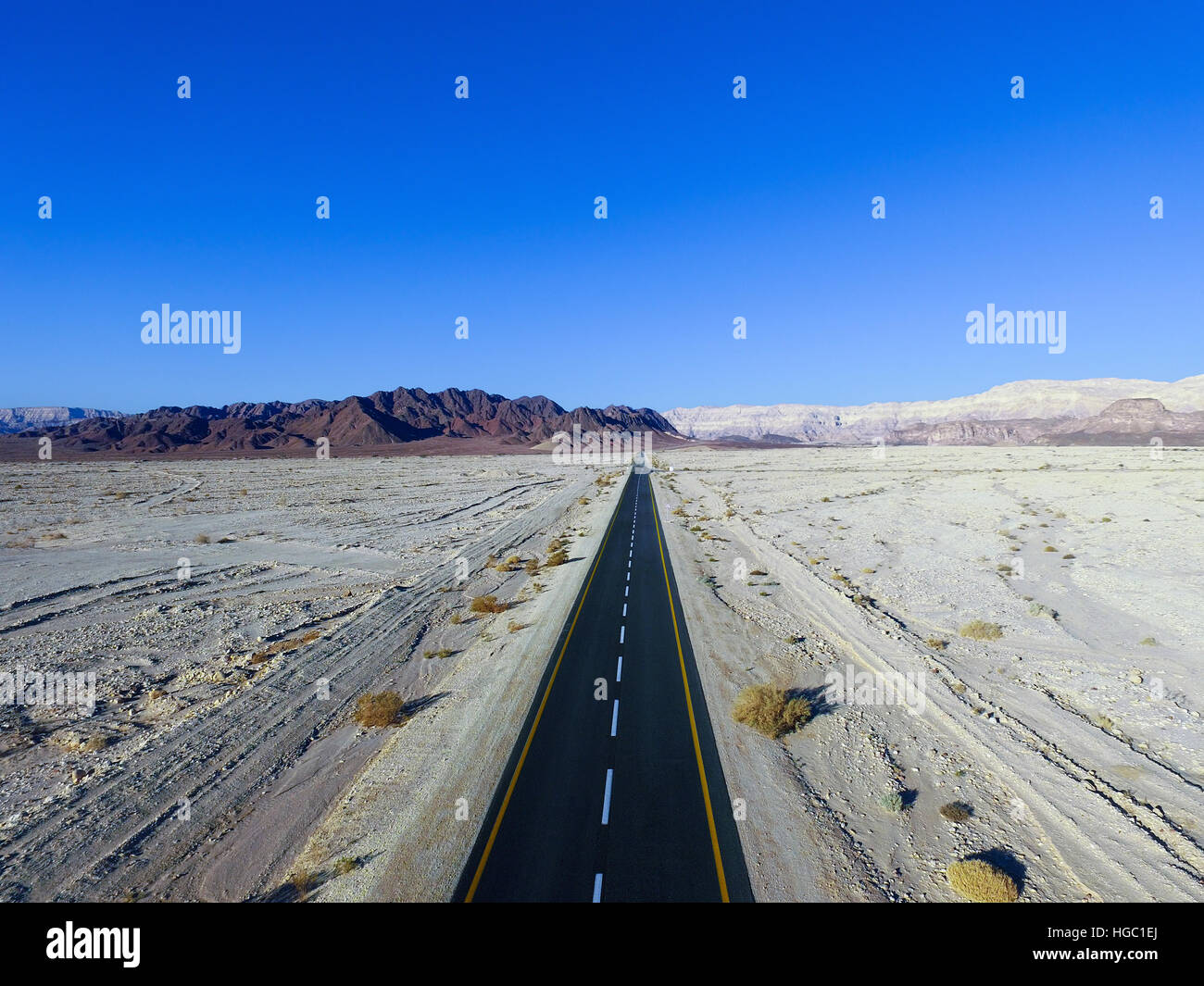 Empty desert road - Aerial image - Stock Image
