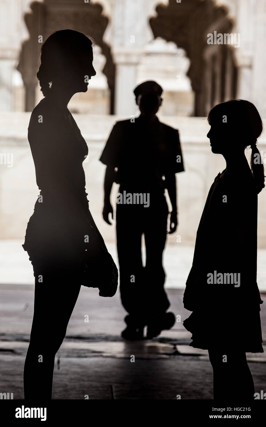 Silohuettes of girls with policeman - Stock Image