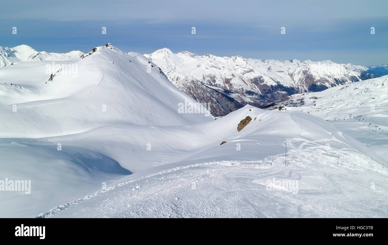 Snow mountains peaks landscape viewed from skiing piste in 3 Valleys winter resort - Stock Image