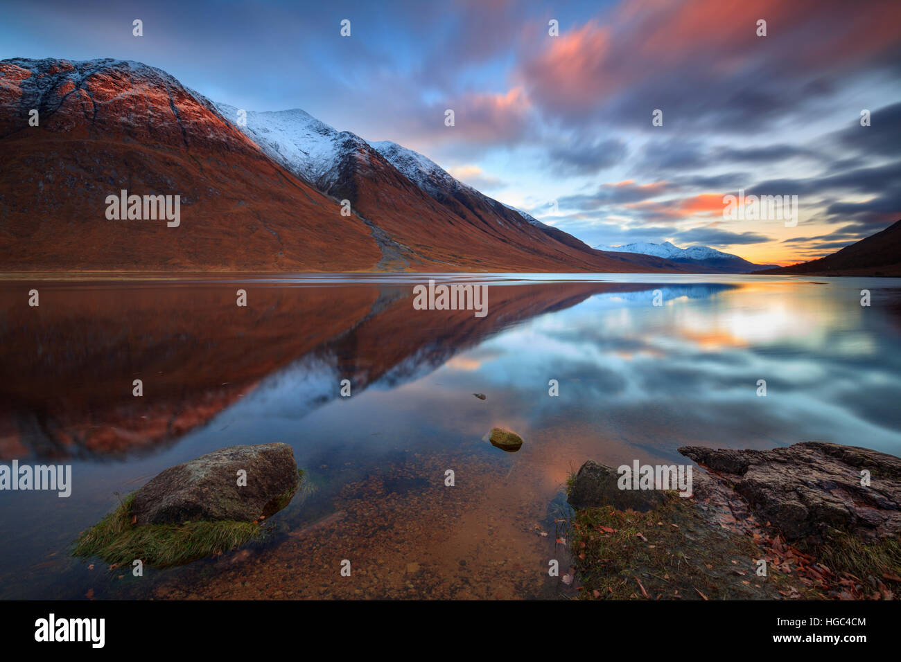 Sunset reflected in Loch Etive captured from near Gualachulain in the Scottish Highland. - Stock Image