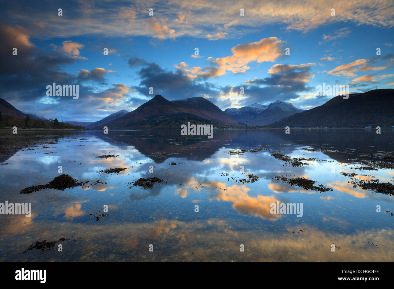 Sunset captured from the North Shore of Loch Leven in the Scottish Highlands with the Pap of Glencoe in the distance. - Stock Image