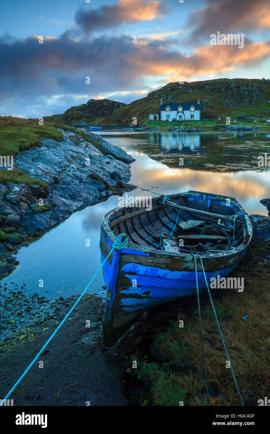 A boat on Ob Leasaid on the Isle of Harris captured at sunrise. - Stock Image