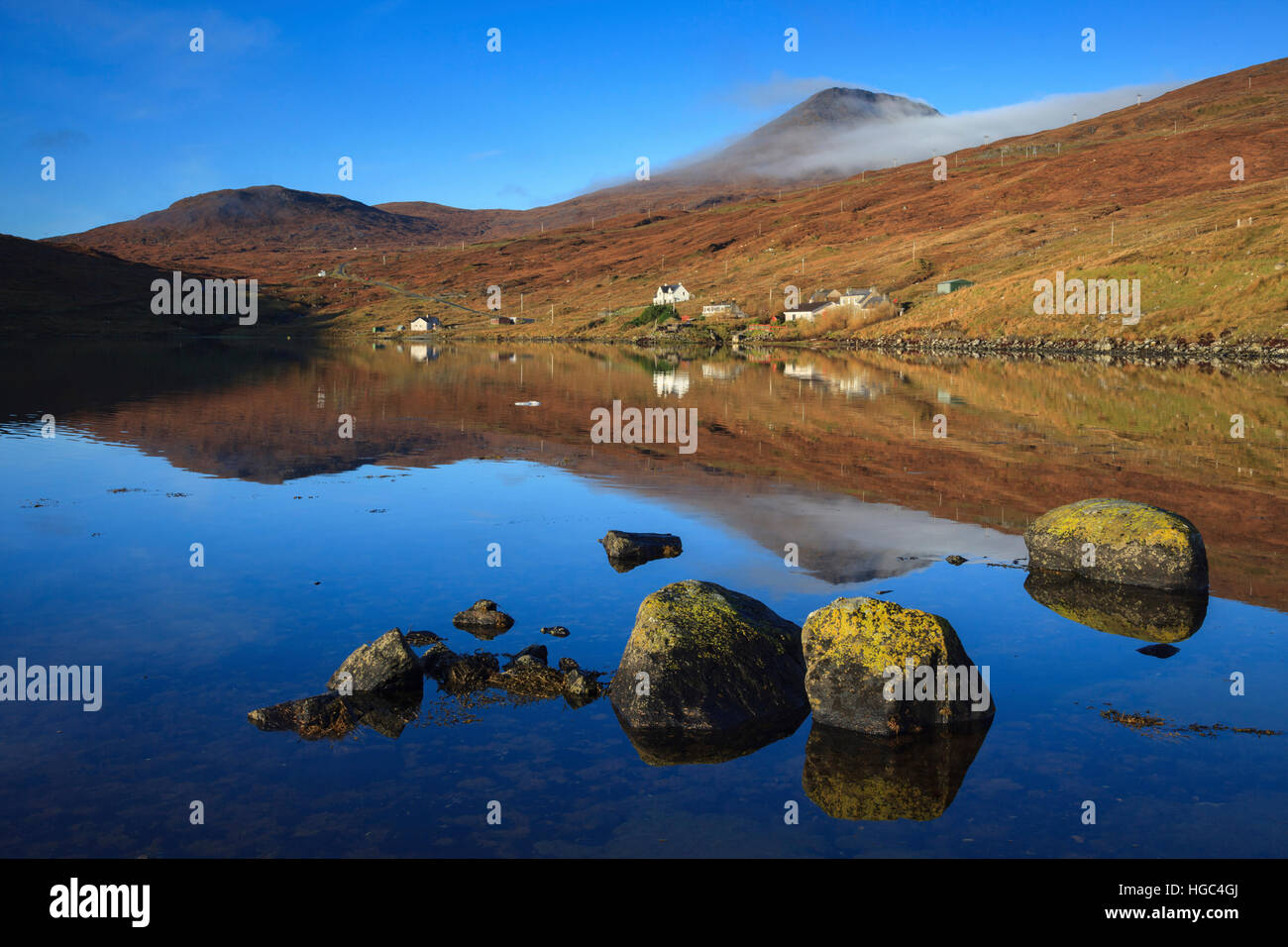 Loch Mharaig with An Clisean, the highest mountain on the Isle of Harris in the distance. - Stock Image