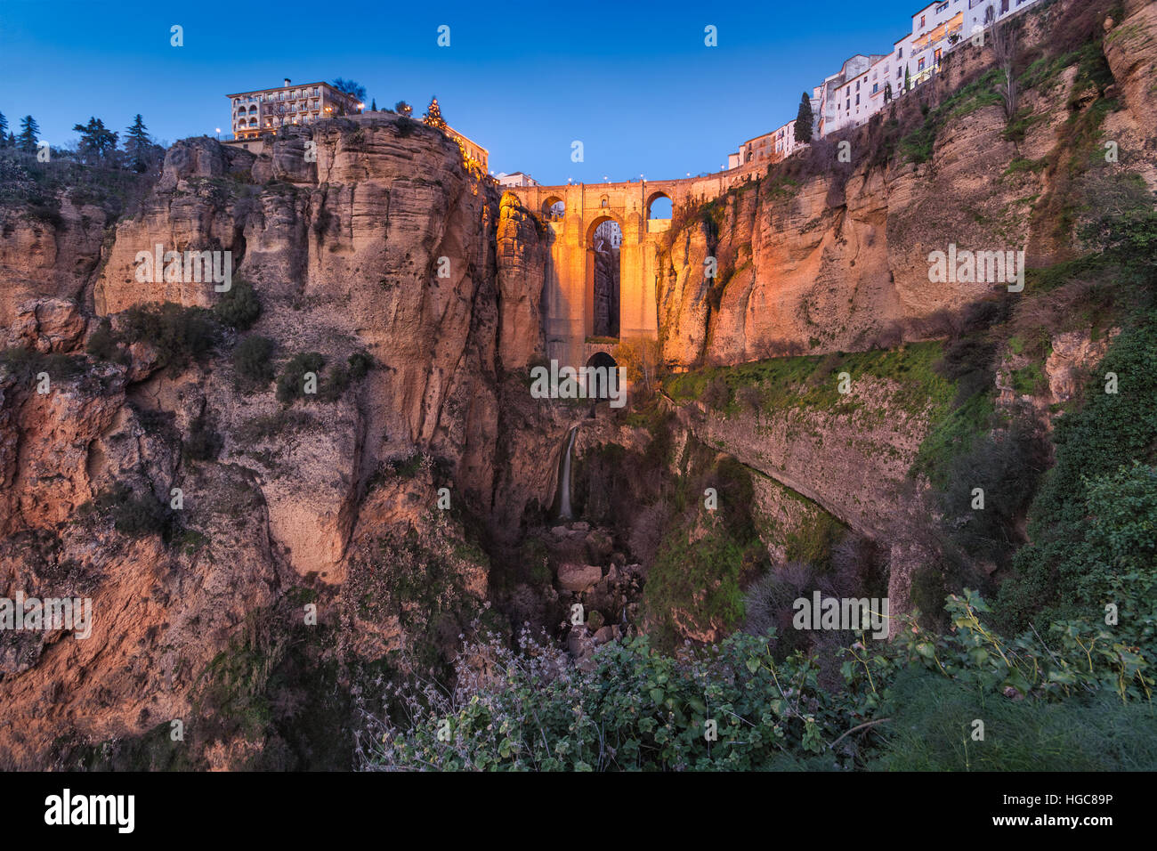 The 'Puente Nuevo' and the 'Tajo' of Ronda at blue hour - Stock Image