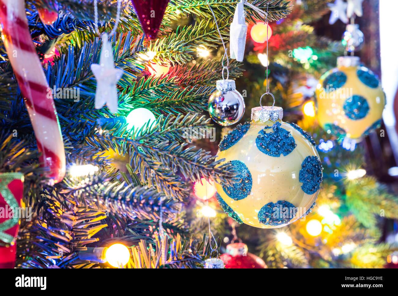 Christmas Tree Decorations Yellow Shiny Finish Orb With Blue Stock Photo Alamy
