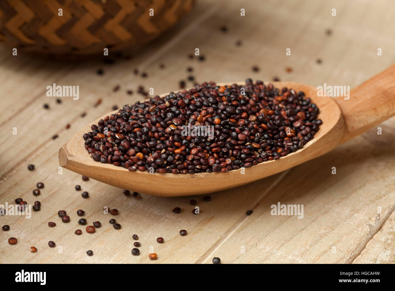 Black quinoa on a wooden spoon - Stock Image