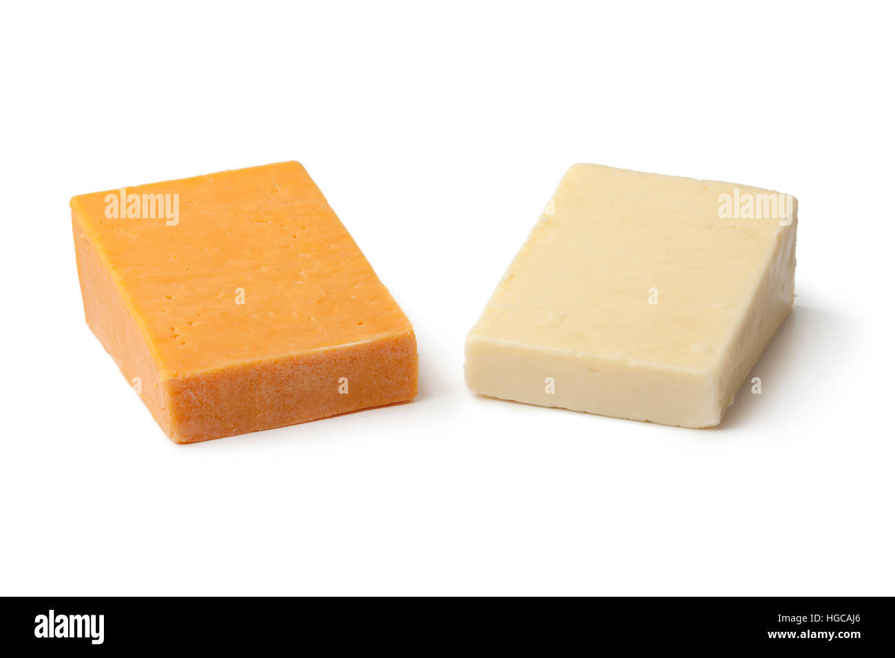 Pieces of traditional english cheese, red leicester and mature cheddar on white background - Stock Image