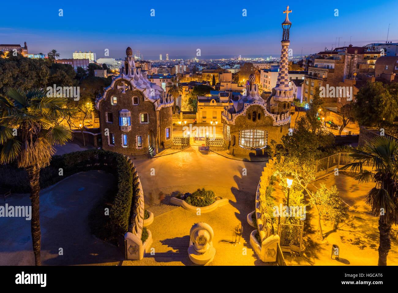 Night view of Park Guell with city skyline behind, Barcelona, Catalonia, Spain - Stock Image