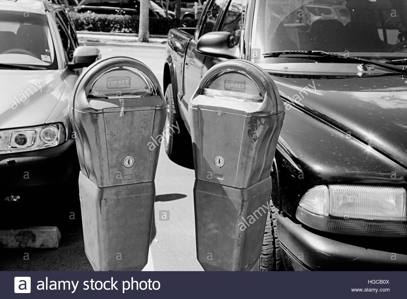 parking meters expired black white - Stock Image