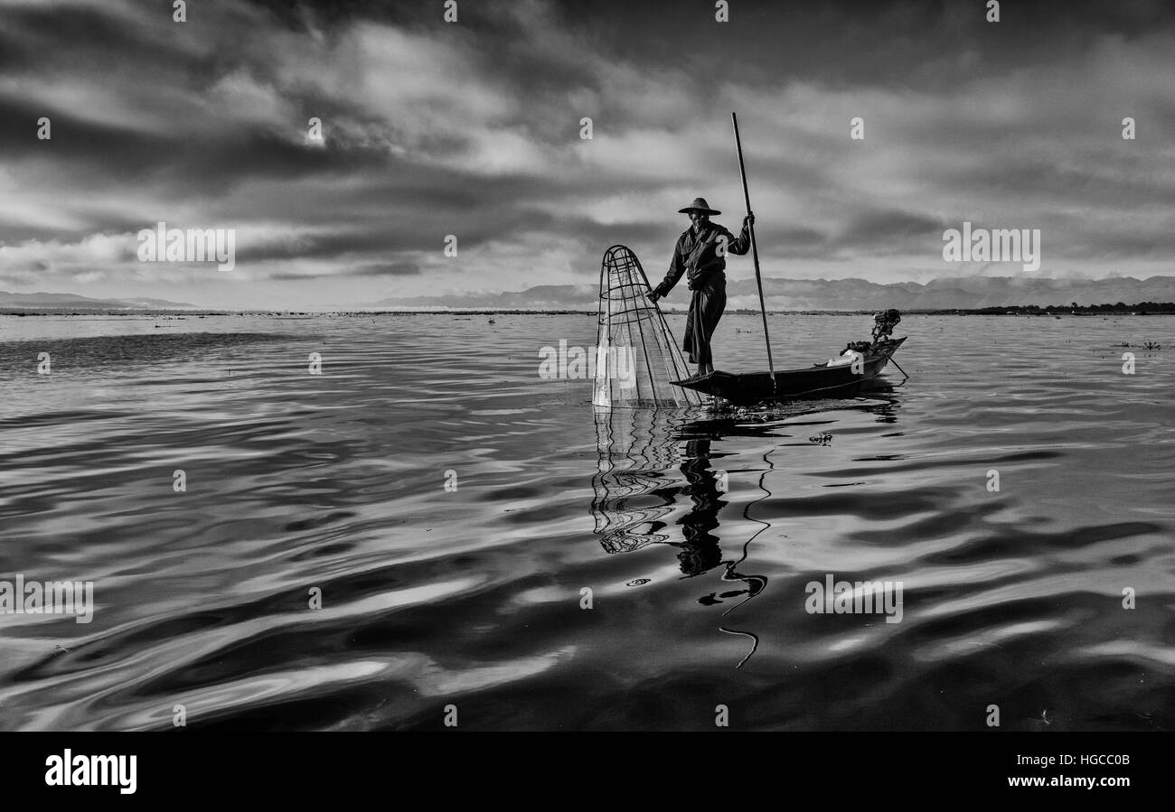 Basket fisherman in the early morning on Inle Lake, Myanmar (Burma) - Stock Image