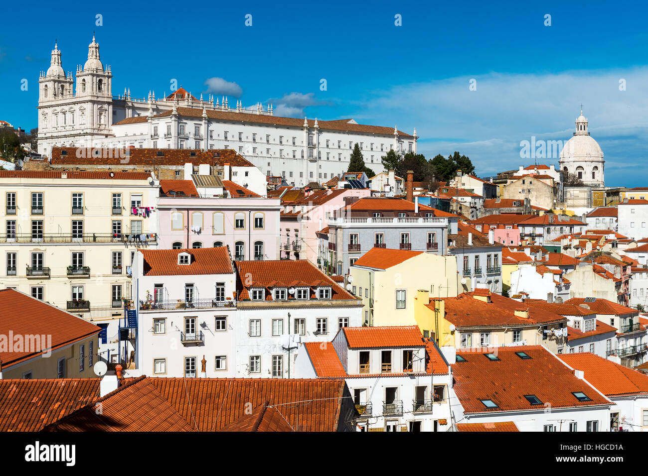View of the Alfama Neighborhood in Lisbon, Portugal, with colorful buildings and the National Pantheon - Stock Image
