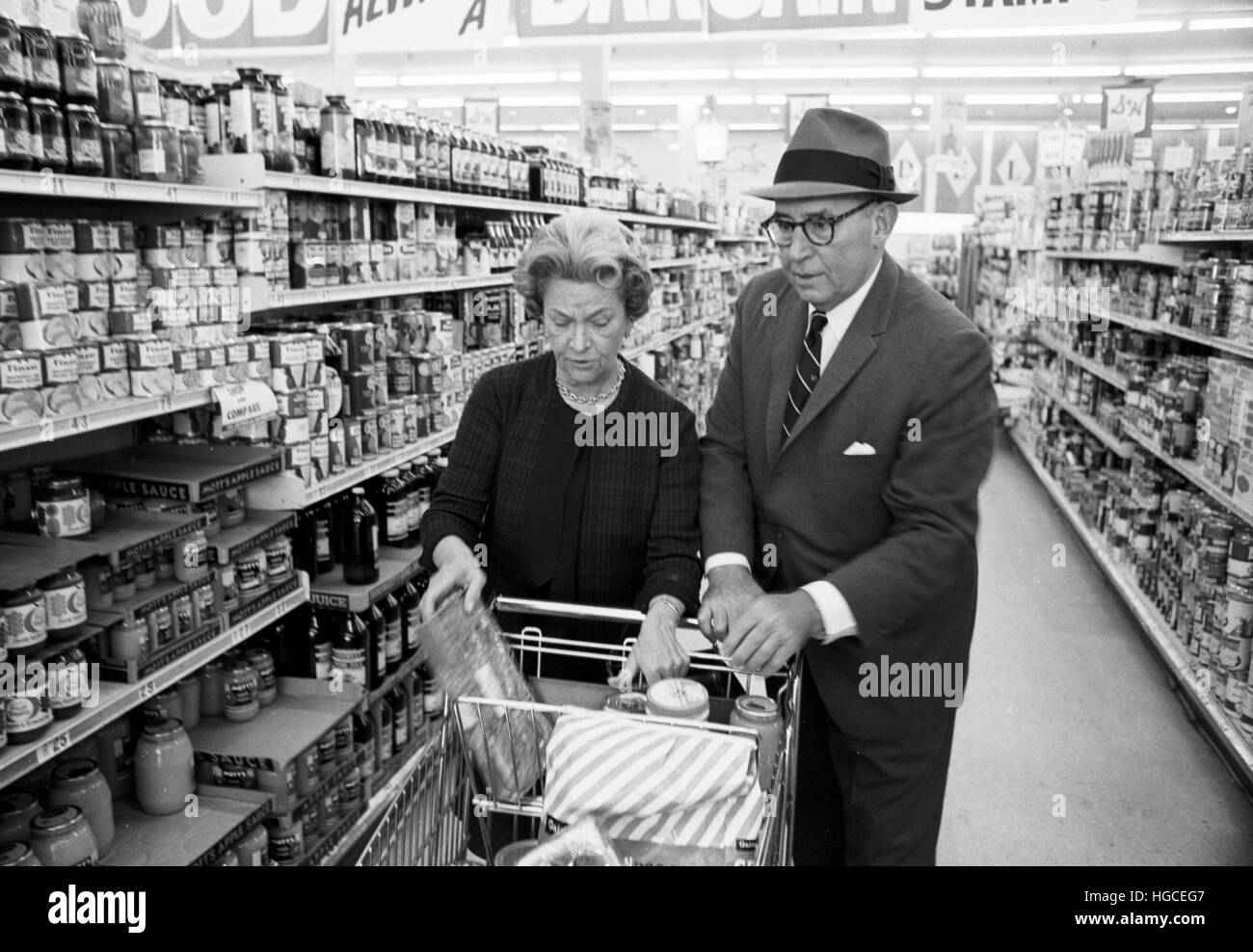 Charles G. Mortimer, shopping for General Foods products with his wife. - Stock Image