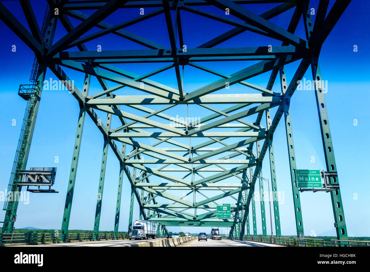 Maine Piscataqua River Bridge with Maine State Line Sign on the middle of the bridge. Piscataqua River is the boundary - Stock Image