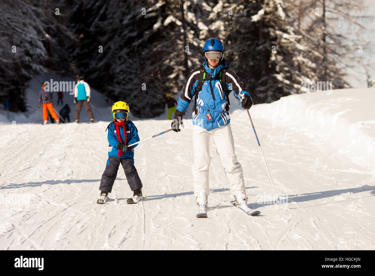 Father and son, preschool child, skiing in austrian ski resort in the mountains, wintertime - Stock Image