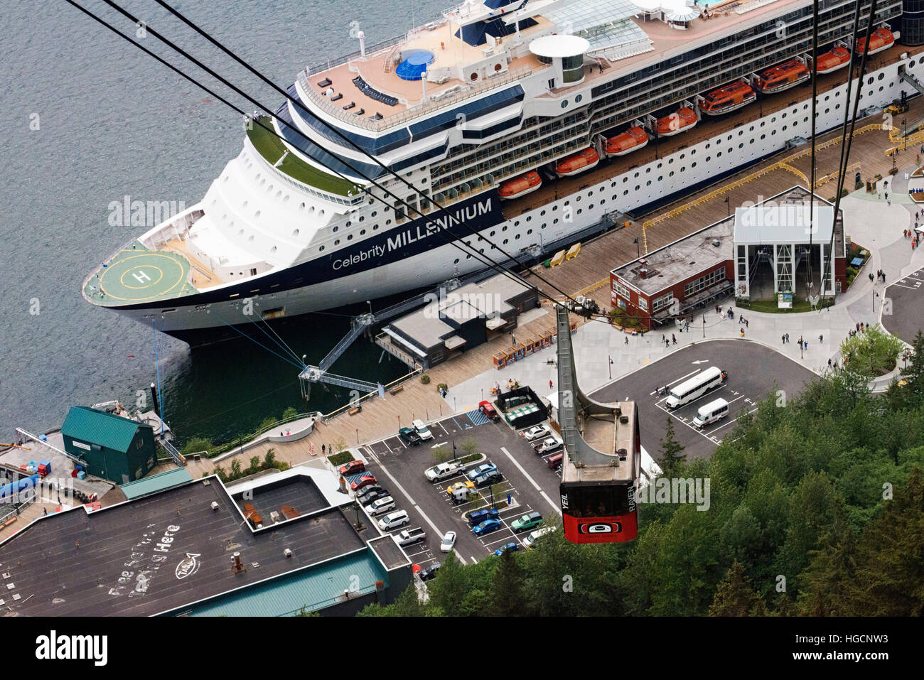 Juneau downtown, city. Alaska. USA. Celebrity Millennium cruise ship docked between snow capped mountains and the - Stock Image