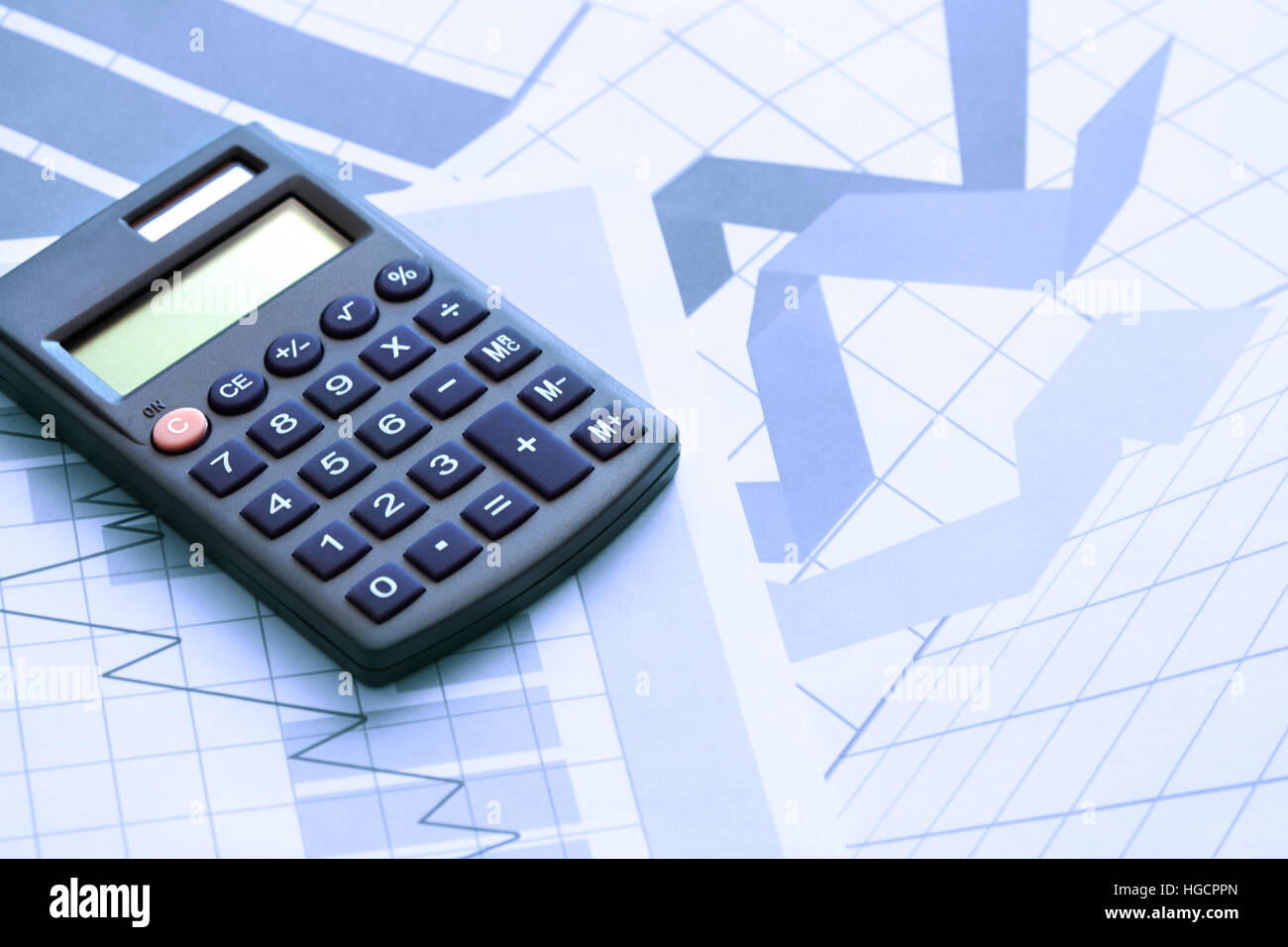 Business Concept Calculator On Paper Background With