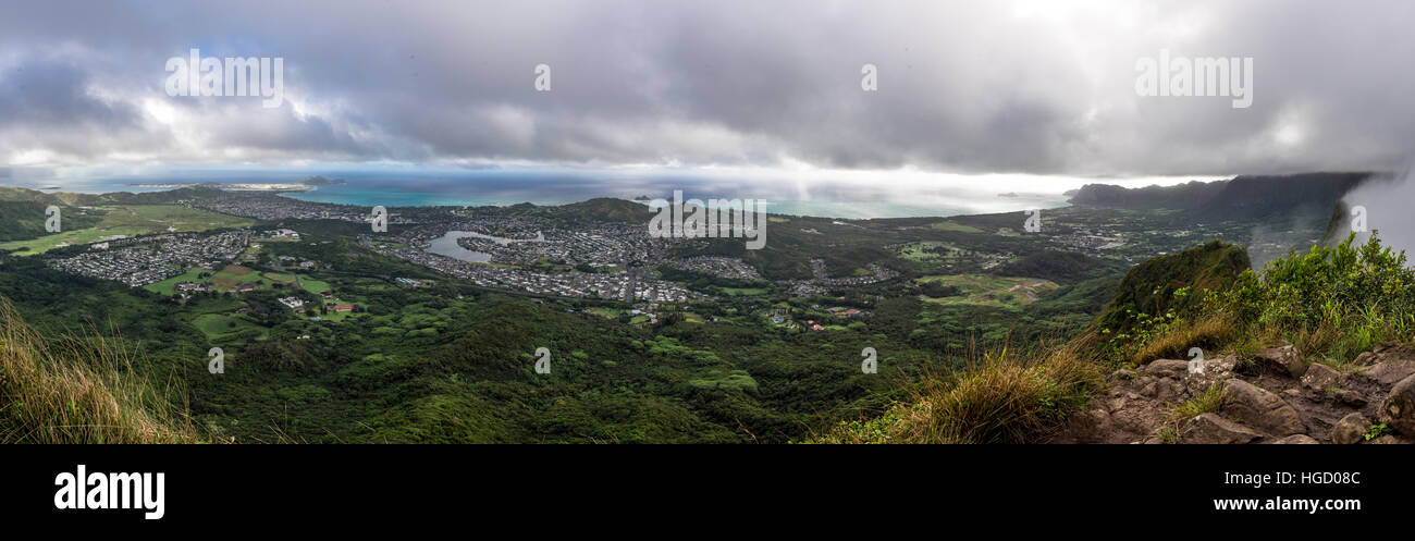Panoramic picture of Kaneohe and the Marine Corps base from the top of the Olomana trail also known as 3 peaks. - Stock Image