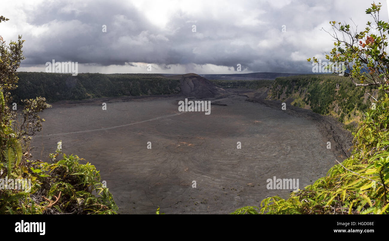 A panoramic shot from the bottom of Kilauea crater. The volcano created vast lava fields that can now be walked - Stock Image