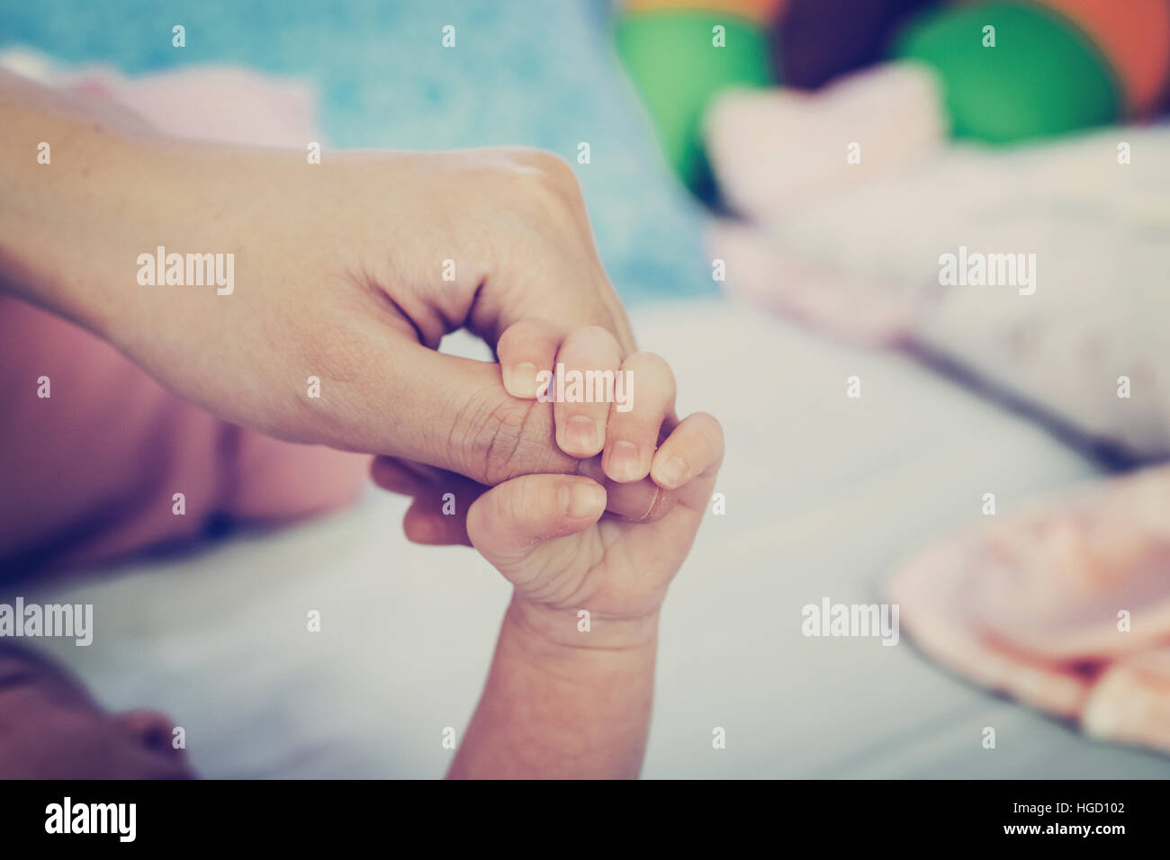 Close up hands of mother and baby - Stock Image