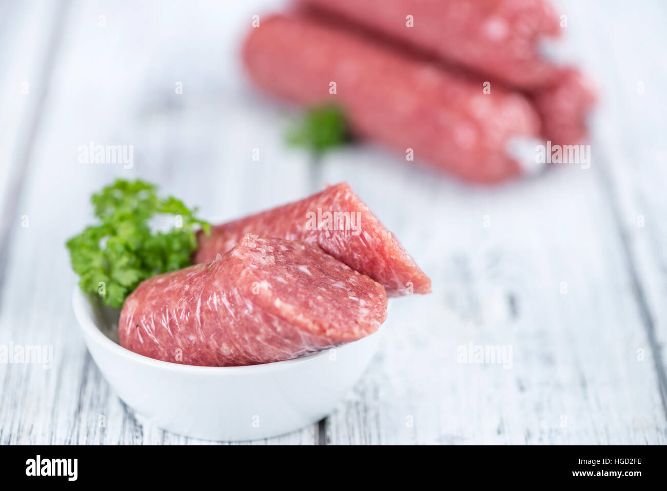 Minced Pork Sausage (German cuisine; selective focus) on wooden background - Stock Image
