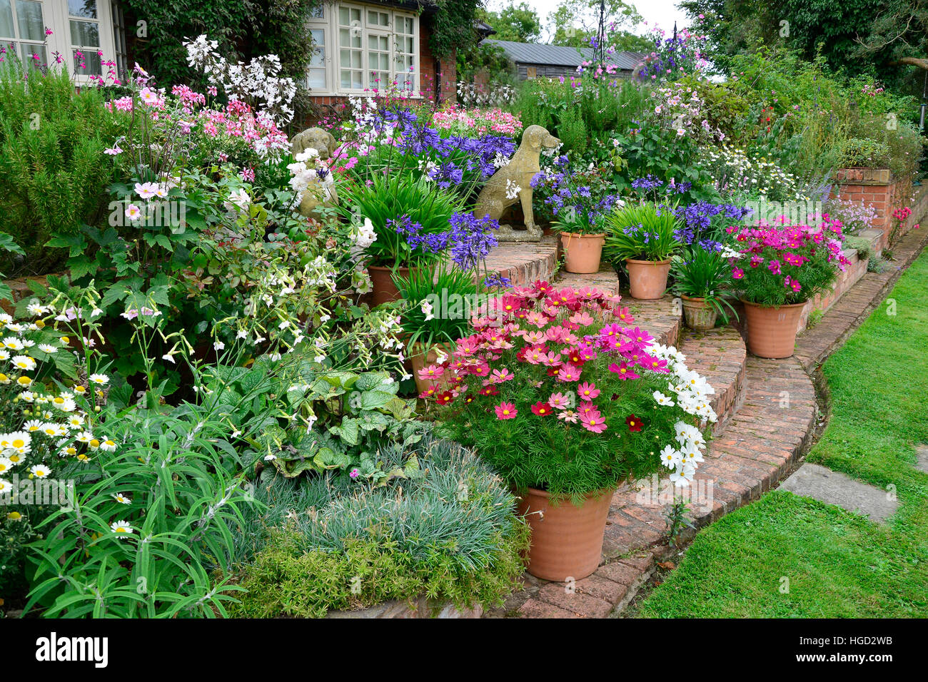 Colourful Garden Terrace With Mixed Flower Beds And Planted Stock