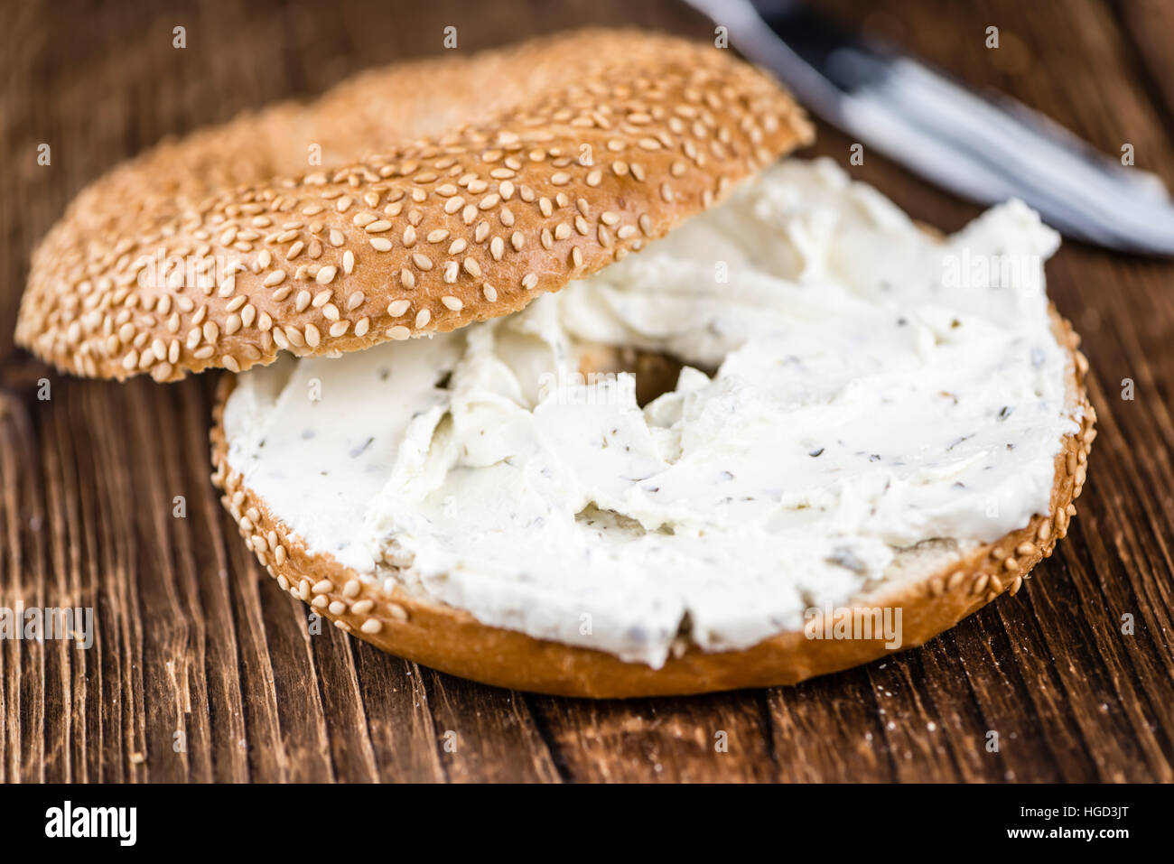 Breakfast sesame Bagel with cream cheese (selective focus; close-up shot) - Stock Image