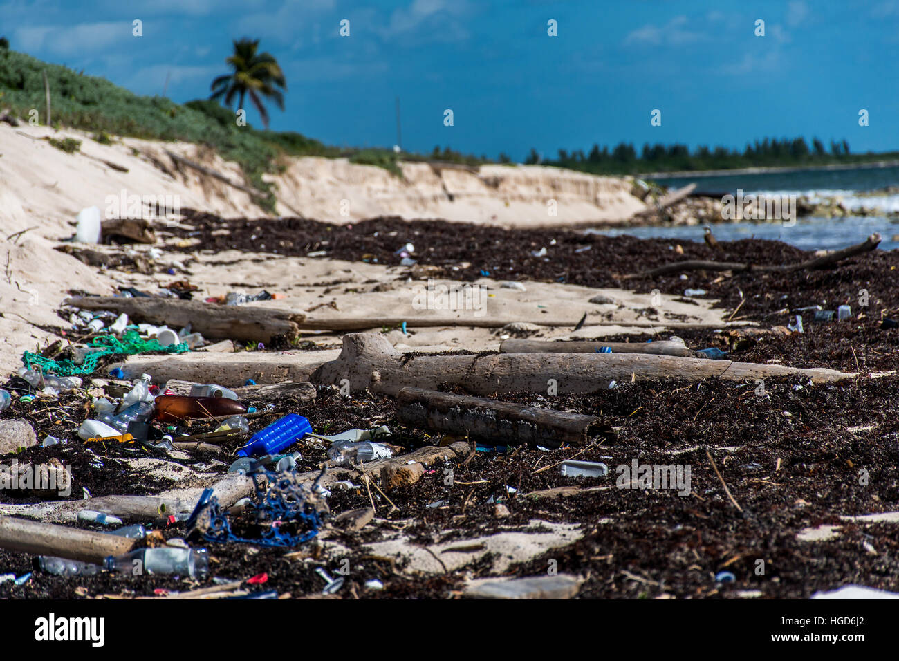 Mexico Coastline ocean Pollution Problem with plastic litter 2 - Stock Image