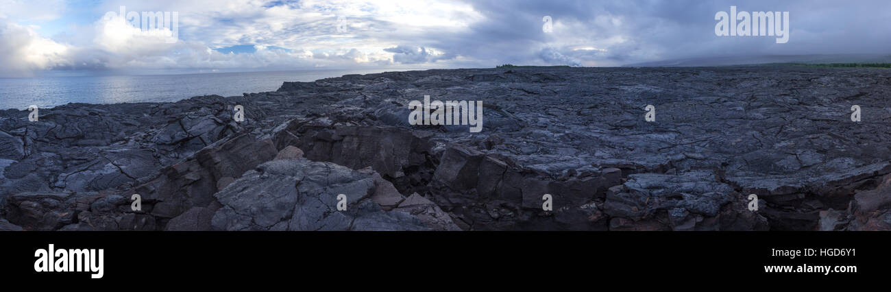 This is a panoramic shot of the vast lava fields of Kalapana. You can see the steam in the distance where lava meets - Stock Image
