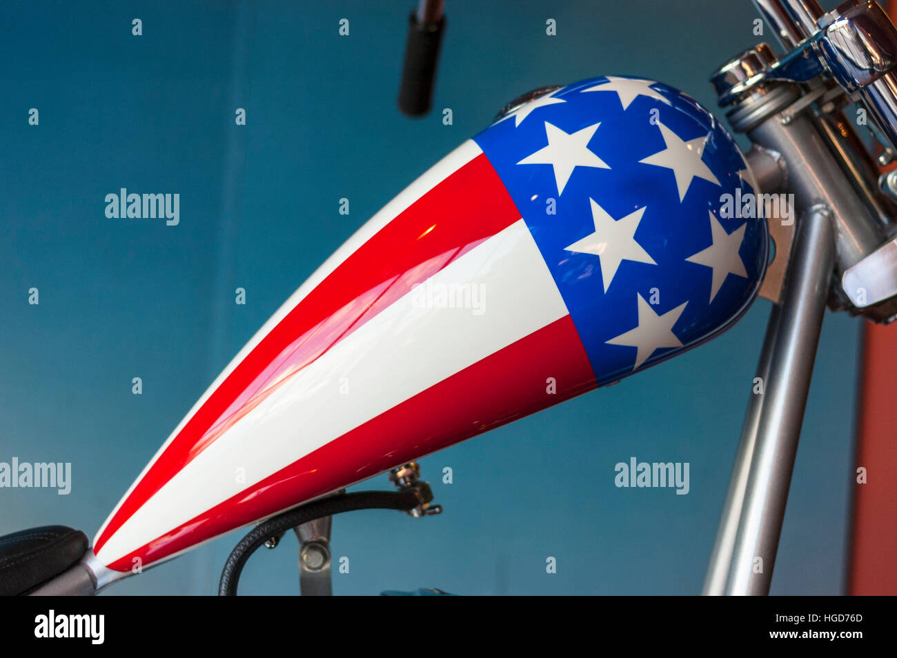 Customized Easy Rider motorbike Harley-Davidson motorcycle fuel tank painted with the colors of the American flag. - Stock Image