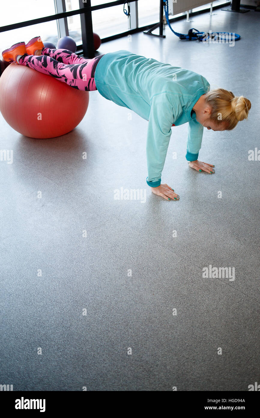 Photo of sportswoman in gym - Stock Image