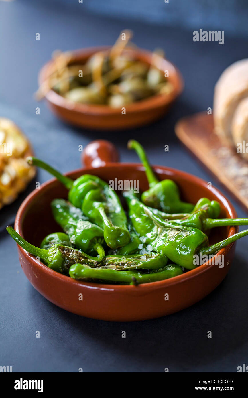 Authentic Spanish tapas with padron peppers - Stock Image