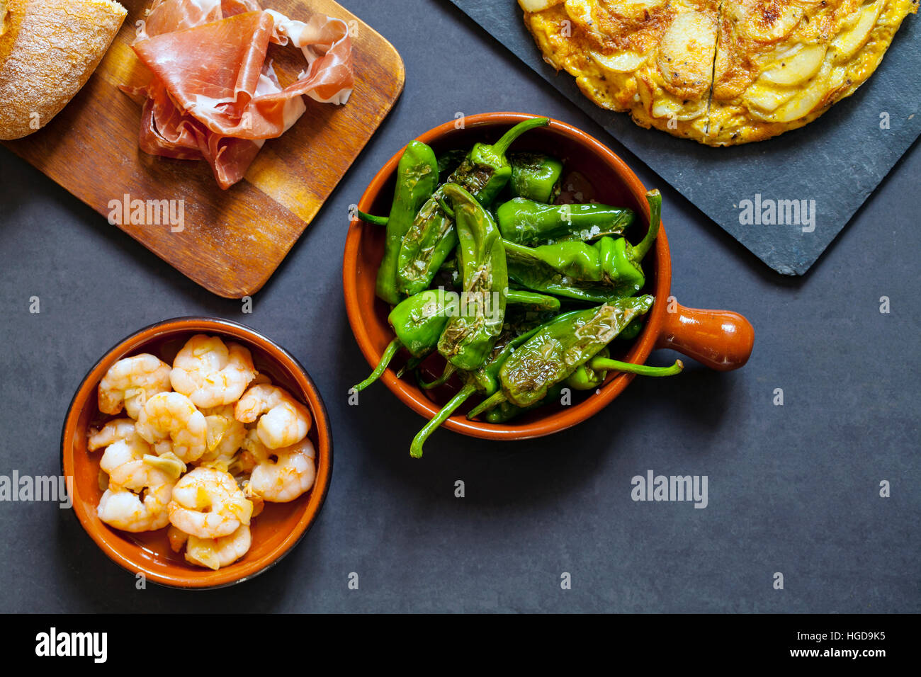 Authentic Spanish tapas with padron peppers,  garlic prawns and traditional tortilla Stock Photo