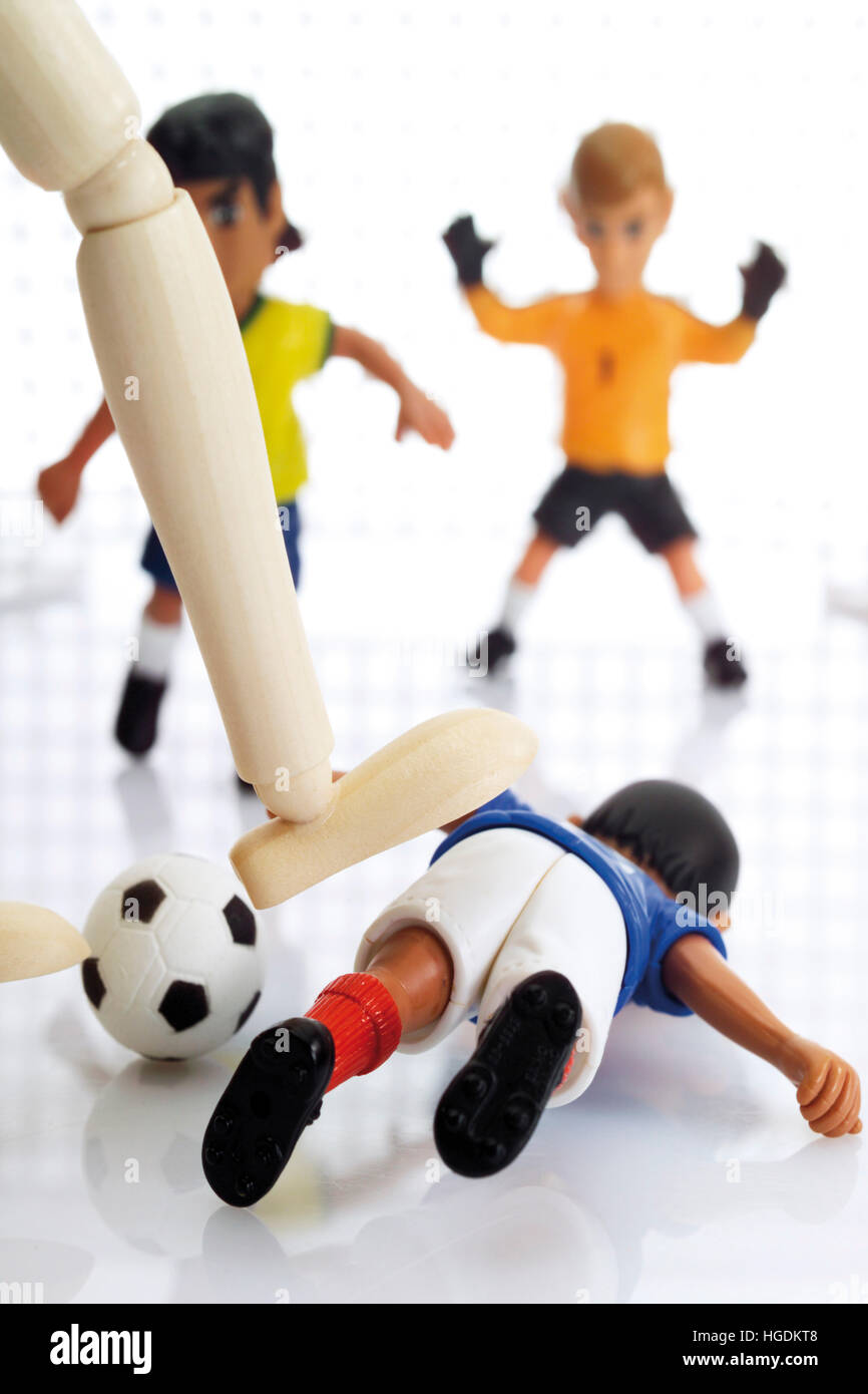Wooden leg brutally fouling a football player - Stock Image