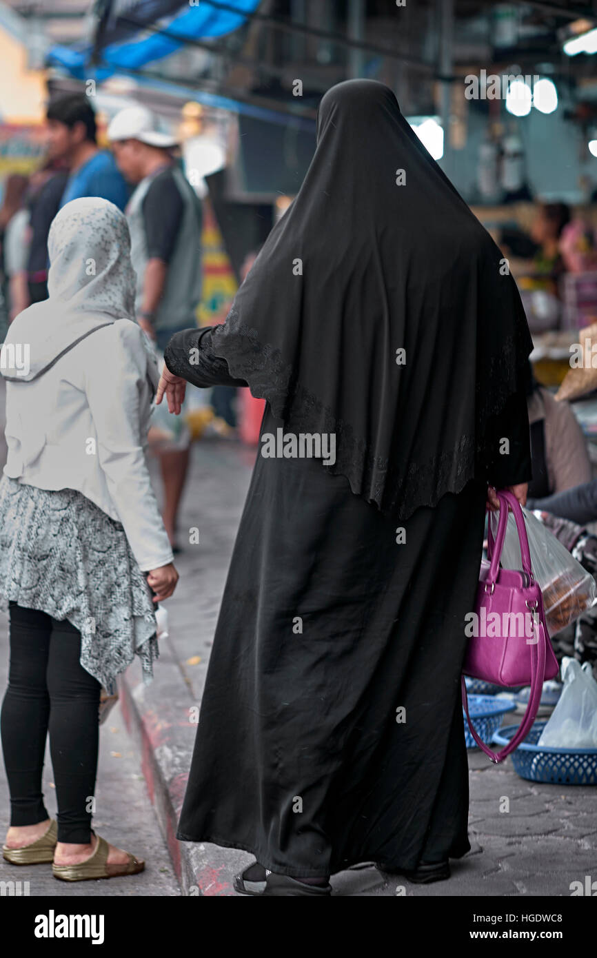 Muslim woman with full black Burka. - Stock Image