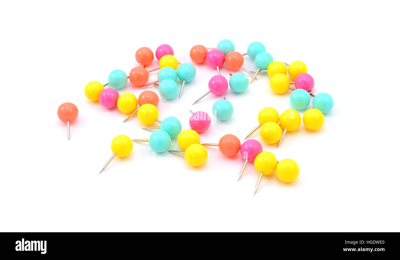 Neon coloured push pins - yellow, orange, pink and turquoise -  isolated on a white background - Stock Image