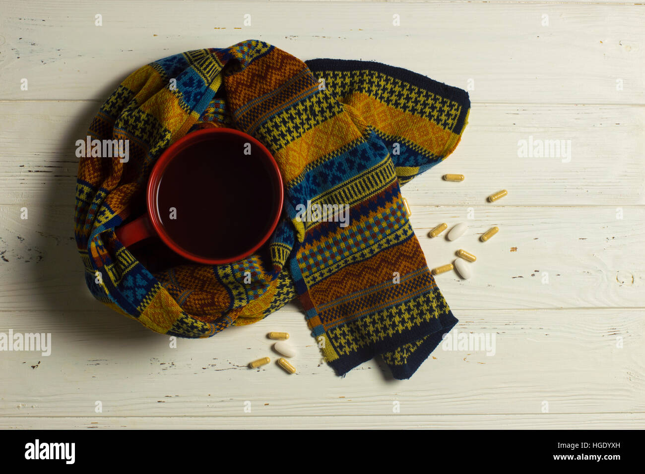 Mug of Tea, Scarf, and Pills: Winter Illness Safety Concept - Stock Image
