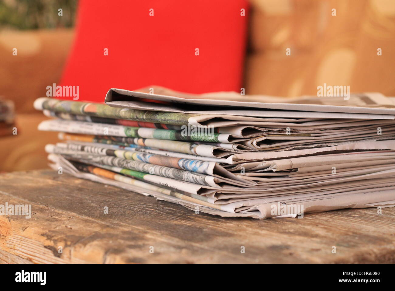Newspapers on wooden table - Stock Image